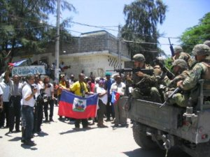 US Marines Point Guns at Un-armed Haitian demonstrators in 2004